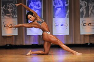 Angela Yeo competiting flexing and posing