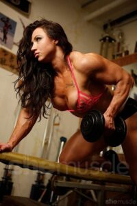 Brandi M. Do some Single-Arm Dumbbell Row at sexy gym