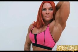 Redhead bodybuilding woman flexes her big arms to show off