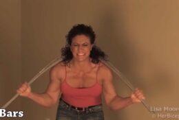 Strong women Lisa Moordigian Bending Iron Around Her Neck