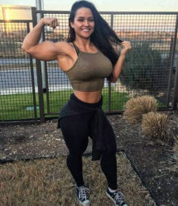 Blue eyed brunette with massive arms and strong body Renee Enos