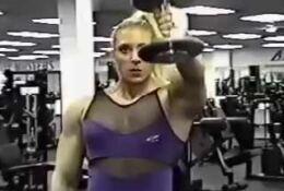 Massive muscle blonde works out her shoulder