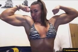 Female with muscle posing sexy on cam